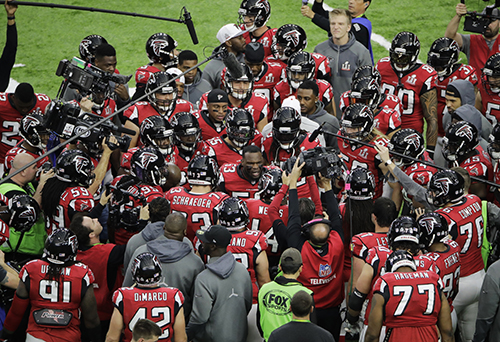 <div class='meta'><div class='origin-logo' data-origin='AP'></div><span class='caption-text' data-credit='AP'>Members of the Atlanta Falcons gather on the field before the NFL Super Bowl 51 football game against the New England Patriots, Sunday, Feb. 5, 2017, in Houston.</span></div>