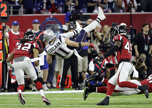<div class='meta'><div class='origin-logo' data-origin='AP'></div><span class='caption-text' data-credit='AP'>New England Patriots' Julian Edelman (11) is upended by Atlanta Falcons' Philip Wheeler during the first half of the NFL Super Bowl 51 football game.</span></div>