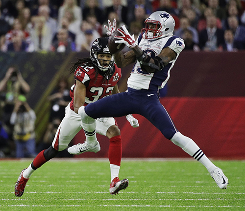 <div class='meta'><div class='origin-logo' data-origin='AP'></div><span class='caption-text' data-credit='AP'>New England Patriots' Malcolm Mitchell, right, catches a pass under pressure from Atlanta Falcons' Jalen Collins during the first half.</span></div>