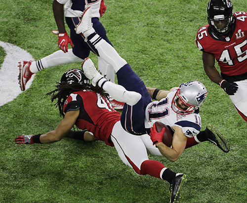 <div class='meta'><div class='origin-logo' data-origin='AP'></div><span class='caption-text' data-credit='AP'>New England Patriots' Julian Edelman, top, is tackled by Atlanta Falcons' Philip Wheeler during the first half of the NFL Super Bowl 51 football game Sunday, Feb. 5, 2017.</span></div>