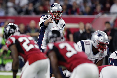 <div class='meta'><div class='origin-logo' data-origin='AP'></div><span class='caption-text' data-credit='AP'>New England Patriots' Tom Brady calls an audible from the line of scrimmage in the first half of the NFL Super Bowl 51 football game against the Atlanta Falcons.</span></div>