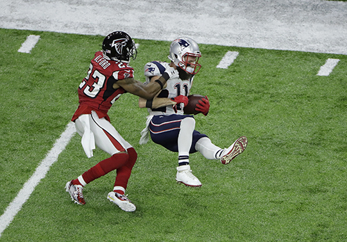 <div class='meta'><div class='origin-logo' data-origin='AP'></div><span class='caption-text' data-credit='AP'>New England Patriots' Julian Edelman (11) is tackled by Atlanta Falcons' Robert Alford during the first half of the NFL Super Bowl 51 football game Sunday, Feb. 5, 2017, in Houston</span></div>