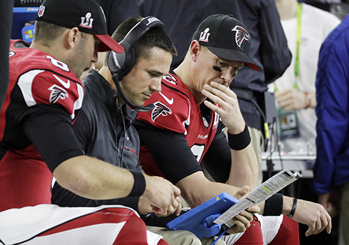<div class='meta'><div class='origin-logo' data-origin='AP'></div><span class='caption-text' data-credit='AP'>Atlanta Falcons' Matt Ryan, right, on the sidelines against the New England Patriots during the first half of the NFL Super Bowl 51 football game Sunday, Feb. 5, 2017.</span></div>