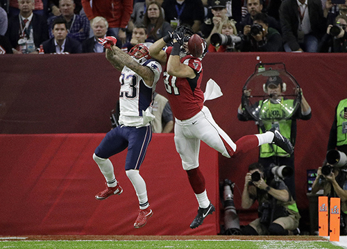<div class='meta'><div class='origin-logo' data-origin='AP'></div><span class='caption-text' data-credit='AP'>New England Patriots' Patrick Chung (23) breaks up a pass intended for Atlanta Falcons' Austin Hooper during the first half of the NFL Super Bowl 51 football game.</span></div>