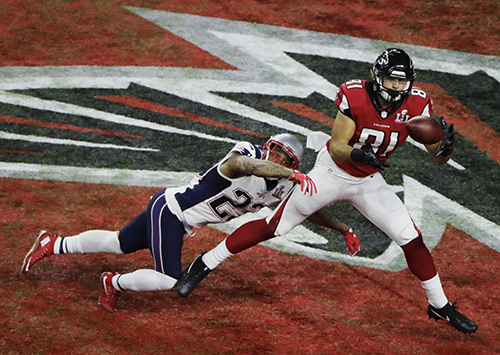 <div class='meta'><div class='origin-logo' data-origin='AP'></div><span class='caption-text' data-credit='AP'>Atlanta Falcons' Austin Hooper catches a touchdown pass ahead of New England Patriots' Patrick Chung during the first half of the NFL Super Bowl 51 football game.</span></div>