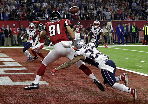 <div class='meta'><div class='origin-logo' data-origin='AP'></div><span class='caption-text' data-credit='AP'>Atlanta Falcons' Austin Hooper (81) makes a touchdown reception against New England Patriots' Patrick Chung (23) during the first half of the NFL Super Bowl 51 football game.</span></div>