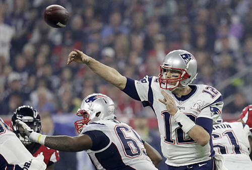 <div class='meta'><div class='origin-logo' data-origin='AP'></div><span class='caption-text' data-credit='AP'>New England Patriots' Tom Brady throws against the Atlanta Falcons during the second half of the NFL Super Bowl 51 football game Sunday, Feb. 5, 2017, in Houston.</span></div>