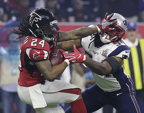 <div class='meta'><div class='origin-logo' data-origin='AP'></div><span class='caption-text' data-credit='AP'>Atlanta Falcons' Devonta Freeman runs against New England Patriots' Dont'a Hightower during the second half of the NFL Super Bowl 51 football game Sunday, Feb. 5, 2017, in Houston.</span></div>