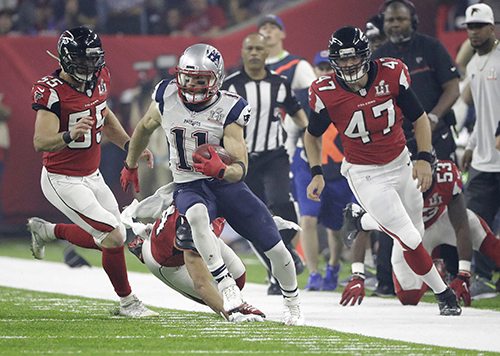 <div class='meta'><div class='origin-logo' data-origin='AP'></div><span class='caption-text' data-credit='AP'>New England Patriots' Julian Edelman (11) runs against the Atlanta Falcons during the second half of the NFL Super Bowl 51 football game Sunday, Feb. 5, 2017, in Houston.</span></div>