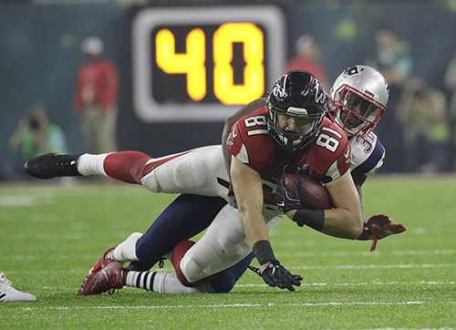 <div class='meta'><div class='origin-logo' data-origin='AP'></div><span class='caption-text' data-credit='AP'>Atlanta Falcons' Austin Hooper, left, is tackled by New England Patriots' Duron Harmon during the second half of the NFL Super Bowl 51 football game Sunday, Feb. 5, 2017.</span></div>