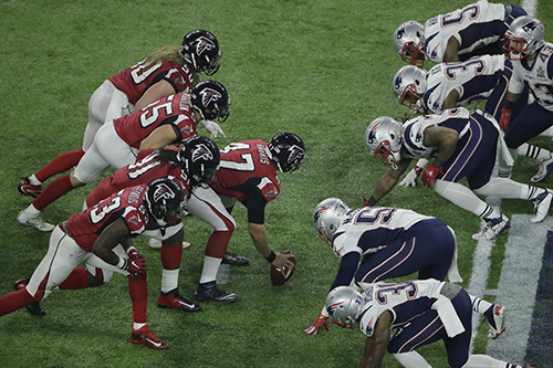 <div class='meta'><div class='origin-logo' data-origin='AP'></div><span class='caption-text' data-credit='AP'>The Atlanta Falcons prepare to snap the ball against the New England Patriots at the line of scrimmage during the second half of the NFL Super Bowl 51 football game.</span></div>