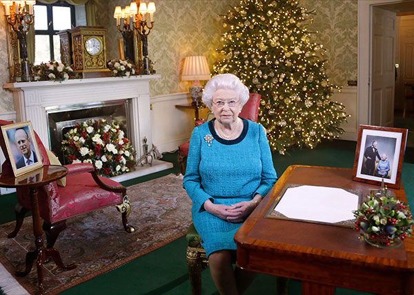 "<div class=""meta image-caption""><div class=""origin-logo origin-image none""><span>none</span></div><span class=""caption-text"">In this photo released early Sunday Dec. 25, 2016, Britain's Queen Elizabeth II poses for a photo, sitting at a desk in the Regency Room of Buckingham Palace in London. (Yui Mok/AP Photo)</span></div>"