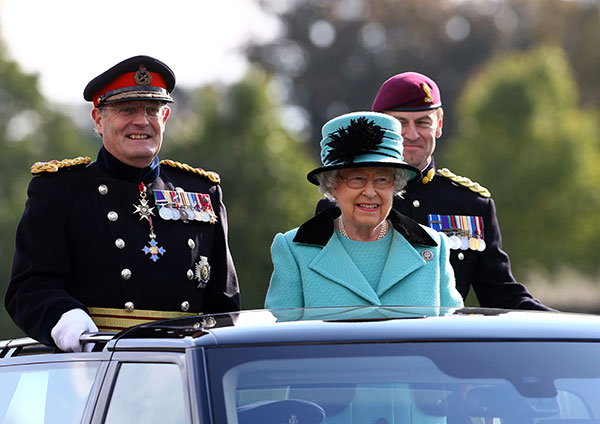 """<div class=""""meta image-caption""""><div class=""""origin-logo origin-image none""""><span>none</span></div><span class=""""caption-text"""">Britain's Queen Elizabeth II, foreground, rides in a vehicle in Chatham, Kent, England, Thursday Oct. 13, 2016. (Gareth Fuller/Pool Photo via AP)</span></div>"""