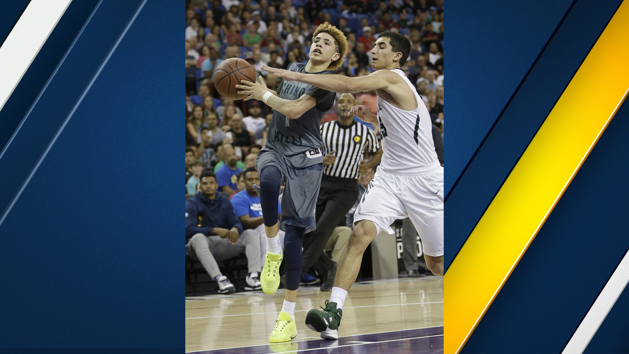Chino Hills' Lamelo Ball, left, goes to the basket during the second half of the CIF boys' Open Division high school basketball championship game Saturday, March 26, 2016.