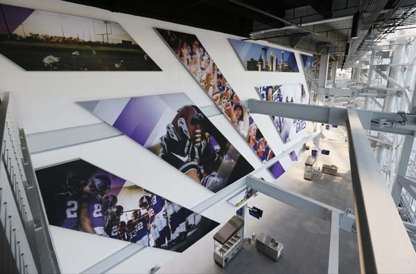 "<div class=""meta image-caption""><div class=""origin-logo origin-image ap""><span>AP</span></div><span class=""caption-text"">Large photos behind the scoreboard adorn the new US Bank stadium  (AP Photo/Jim Mone) (AP)</span></div>"