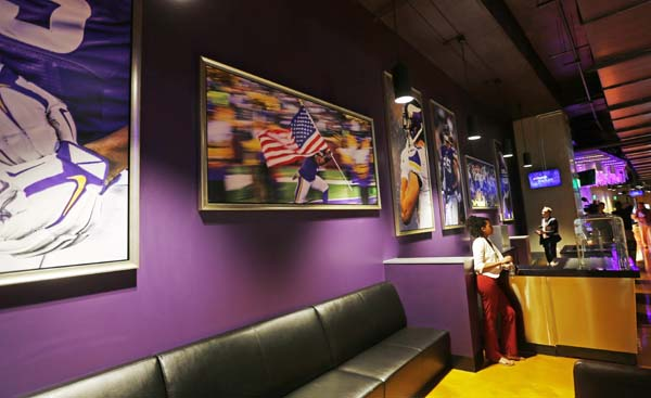 "<div class=""meta image-caption""><div class=""origin-logo origin-image ap""><span>AP</span></div><span class=""caption-text"">Photos line the wall in the area know as the Loft at the new US Bank stadium (AP Photo/Jim Mone) (AP)</span></div>"