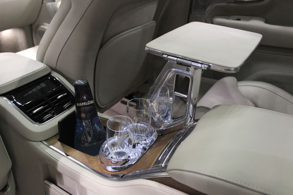 <div class='meta'><div class='origin-logo' data-origin='WLS'></div><span class='caption-text' data-credit=''>Refrigerator with bottle and glass holders inside the 2017 Volvo XC90 on display at the Concept and Technology Garage event at the 2017 Chicago Auto Show on Feb. 8, 2017.</span></div>