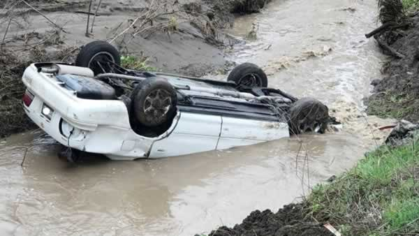 A Good Samaritan pulled a driver from a partially submerged car near Livermore, Calif. on Tuesday, Feb. 2017.