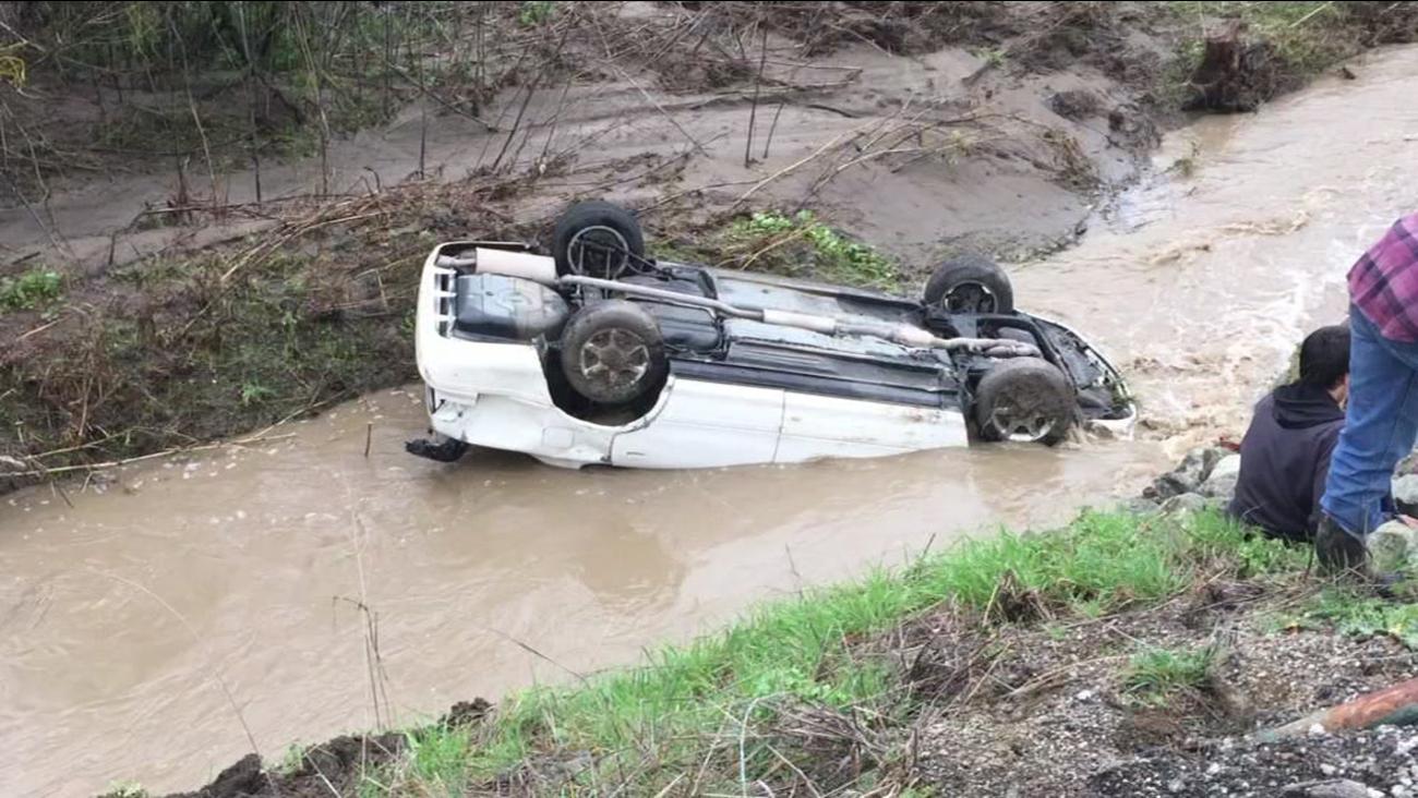 A car flips into Uvas Creek near Dublin, Calif. on Feb. 8, 2017.