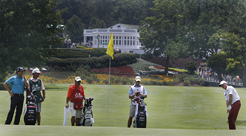 <div class='meta'><div class='origin-logo' data-origin='AP'></div><span class='caption-text' data-credit='AP Photo/Steve Helber'>Jerry Kelly, right, chips up to the first green as caddies and Martin Flores, left, watch during the third round of the Greenbrier Classic PGA Golf tournament.</span></div>