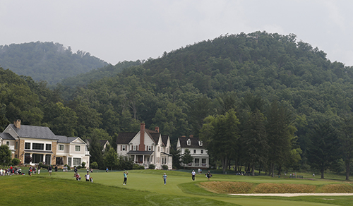 <div class='meta'><div class='origin-logo' data-origin='AP'></div><span class='caption-text' data-credit='AP Photo/Steve Helber'>Tiger Woods, center,  hits up to the 15th green during the first round of the Greenbrier Classic golf tournament.</span></div>