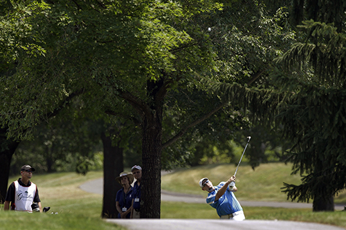 <div class='meta'><div class='origin-logo' data-origin='AP'></div><span class='caption-text' data-credit='AP Photo/Steve Helber'>Troy Kelly hits from behind a cart path on the first fairway during the final round of the Greenbrier Classic PGA Golf tournament.</span></div>