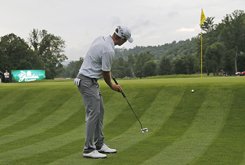 <div class='meta'><div class='origin-logo' data-origin='AP'></div><span class='caption-text' data-credit='AP Photo/Steve Helber'>David Hearn, of Canada, putts up to the 17th green during the second playoff hole of the Greenbrier Classic golf tournament.</span></div>