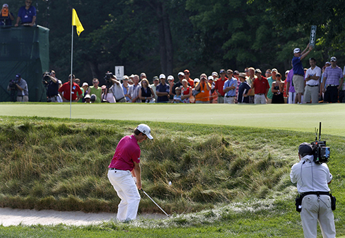 <div class='meta'><div class='origin-logo' data-origin='AP'></div><span class='caption-text' data-credit='AP Photo/Steve Helber'>Webb Simpson chips up to the 12th green during the final round of the Greenbrier Classic PGA Golf tournament at the Greenbrier in White Sulphur Springs.</span></div>