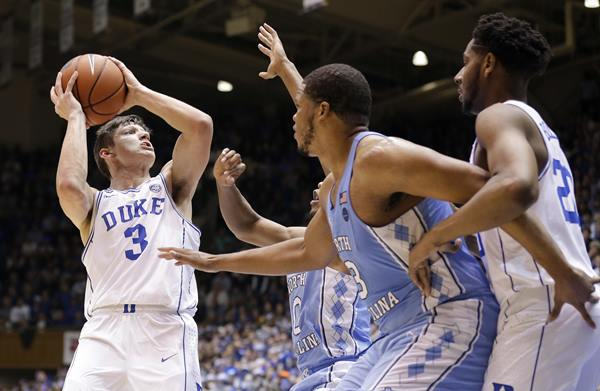 <div class='meta'><div class='origin-logo' data-origin='AP'></div><span class='caption-text' data-credit='Gerry Broome'>Duke's Grayson Allen (3) looks to shoot while North Carolina's Nate Britt, rear, and Kennedy Meeks (3) defend.</span></div>