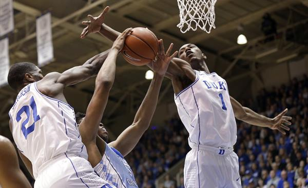 <div class='meta'><div class='origin-logo' data-origin='AP'></div><span class='caption-text' data-credit='Gerry Broome'>Duke's Harry Giles (1) and Amile Jefferson (21) defend North Carolina's Tony Bradley.</span></div>
