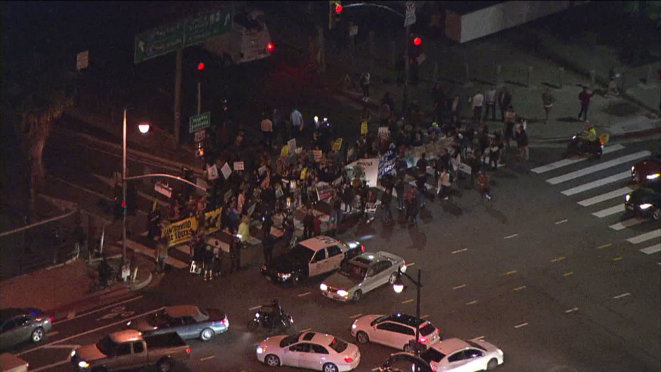 Demonstrators block the onramp to the 101 Freeway in downtown Los Angeles in protest of what they say are increased immigration raids by federal authorities.