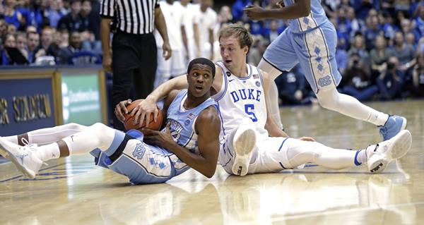 <div class='meta'><div class='origin-logo' data-origin='AP'></div><span class='caption-text' data-credit='Gerry Broome'>North Carolina's Kenny Williams, left, and Duke's Luke Kennard (5) go to the floor.</span></div>