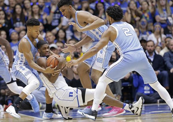 <div class='meta'><div class='origin-logo' data-origin='AP'></div><span class='caption-text' data-credit='Gerry Broome'>North Carolina's Nate Britt, left, Tony Bradley and Joel Berry II (2) guard Duke's Amile Jefferson.</span></div>