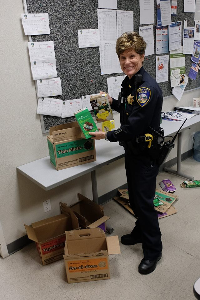 Lisa Graets holds up a box of  Girl Scout cookies in the Union City police break room in Union City, Calif. on Feb. 9, 2017.