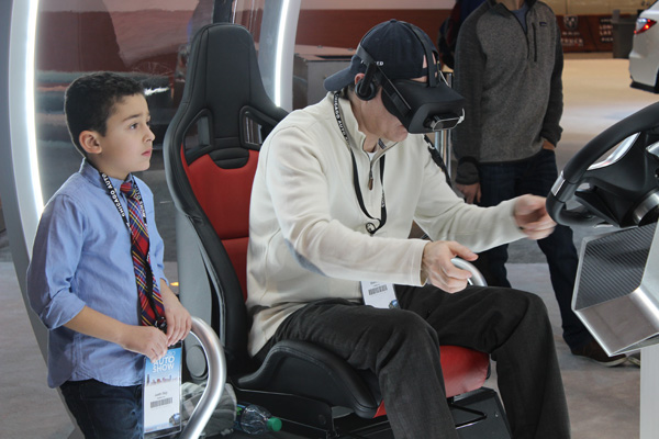 "<div class=""meta image-caption""><div class=""origin-logo origin-image wls""><span>WLS</span></div><span class=""caption-text"">Attendees test out a virtual reality headset at the Acura exhibit at the 2017 Chicago Auto Show on Feb. 10, 2017.</span></div>"