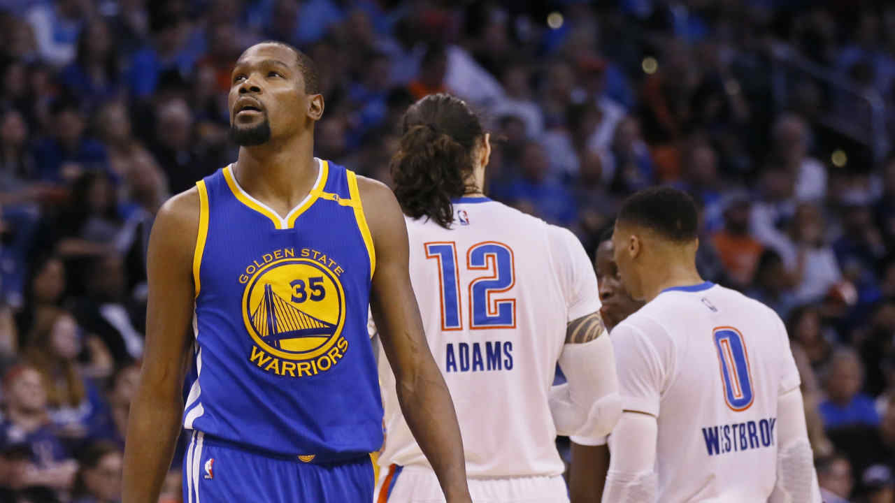 Warriors forward Kevin Durant (35) walks past former teammates Oklahoma City Thunder center Steven Adams (12) and guard Russell Westbrook (AP Photo/Sue Ogrocki)