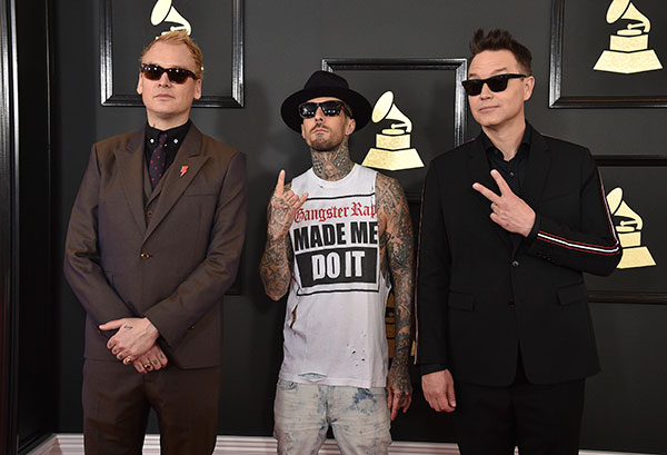 "<div class=""meta image-caption""><div class=""origin-logo origin-image none""><span>none</span></div><span class=""caption-text"">Matt Skiba, from left, Travis Barker, and Mark Hoppus of the musical group Blink-182 arrive at the 59th annual Grammy Awards at the Staples Center on Feb. 12, 2017. (Jordan Strauss/Invision/AP)</span></div>"