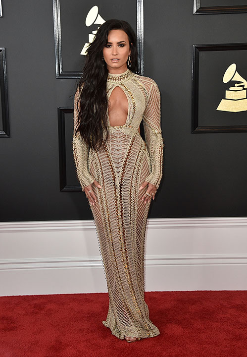 "<div class=""meta image-caption""><div class=""origin-logo origin-image none""><span>none</span></div><span class=""caption-text"">Demi Lovato arrives at the 59th annual Grammy Awards at the Staples Center on Sunday, Feb. 12, 2017, in Los Angeles. (Jordan Strauss/Invision/AP)</span></div>"
