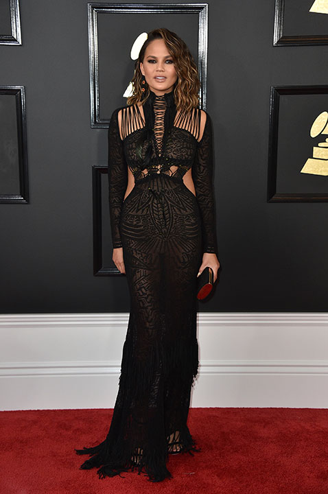 "<div class=""meta image-caption""><div class=""origin-logo origin-image none""><span>none</span></div><span class=""caption-text"">Chrissy Teigen arrives at the 59th annual Grammy Awards at the Staples Center on Sunday, Feb. 12, 2017, in Los Angeles. (Jordan Strauss/Invision/AP)</span></div>"