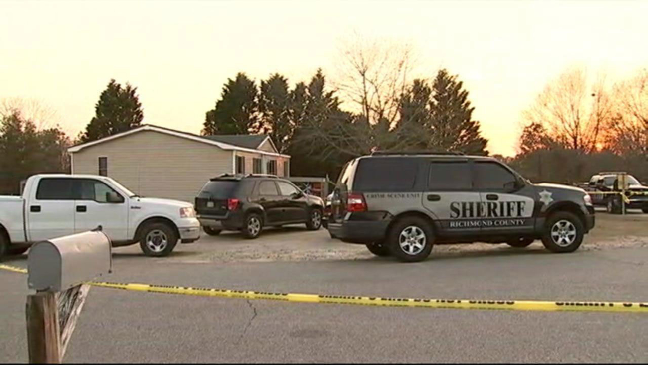 Authorities investigating a triple murder in Richmond County