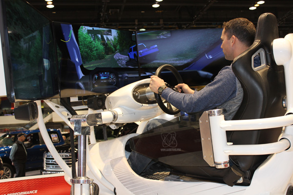 <div class='meta'><div class='origin-logo' data-origin='WLS'></div><span class='caption-text' data-credit=''>A visitor tests his off-road driving skills at the Ford F-150 Raptor Simulator at the 2017 Chicago Auto Show on February 13, 2017.</span></div>