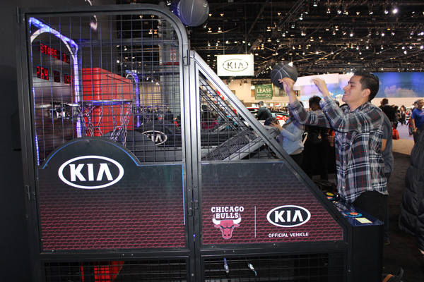 <div class='meta'><div class='origin-logo' data-origin='WLS'></div><span class='caption-text' data-credit=''>A visitor shoots hoops at the Kia exhibit at the 2017 Chicago Auto Show on February 13, 2017.</span></div>