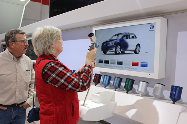 <div class='meta'><div class='origin-logo' data-origin='WLS'></div><span class='caption-text' data-credit=''>Visitors paint their own Volkswagen at the 2017 Chicago Auto Show on February 13, 2017.</span></div>