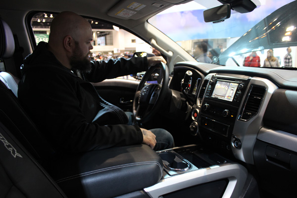 "<div class=""meta image-caption""><div class=""origin-logo origin-image wls""><span>WLS</span></div><span class=""caption-text"">A visitor behind the wheel of a 2017 Nissan Titan Pro-4X at the 2017 Chicago Auto Show on February 13, 2017.</span></div>"