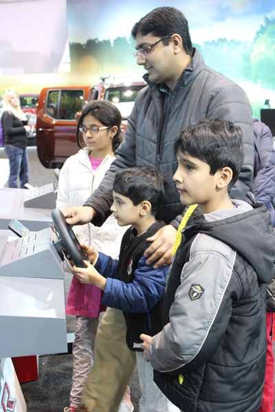 <div class='meta'><div class='origin-logo' data-origin='WLS'></div><span class='caption-text' data-credit=''>Visitors try out the Nissan GT R Virtual Racing Track at the 2017 Chicago Auto Show on February 13, 2017.</span></div>