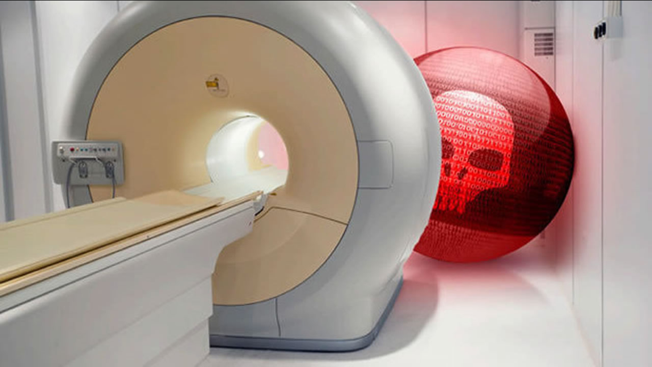This is an undated image of an MRI machine with graphics from San Mateo's TrapX Security.