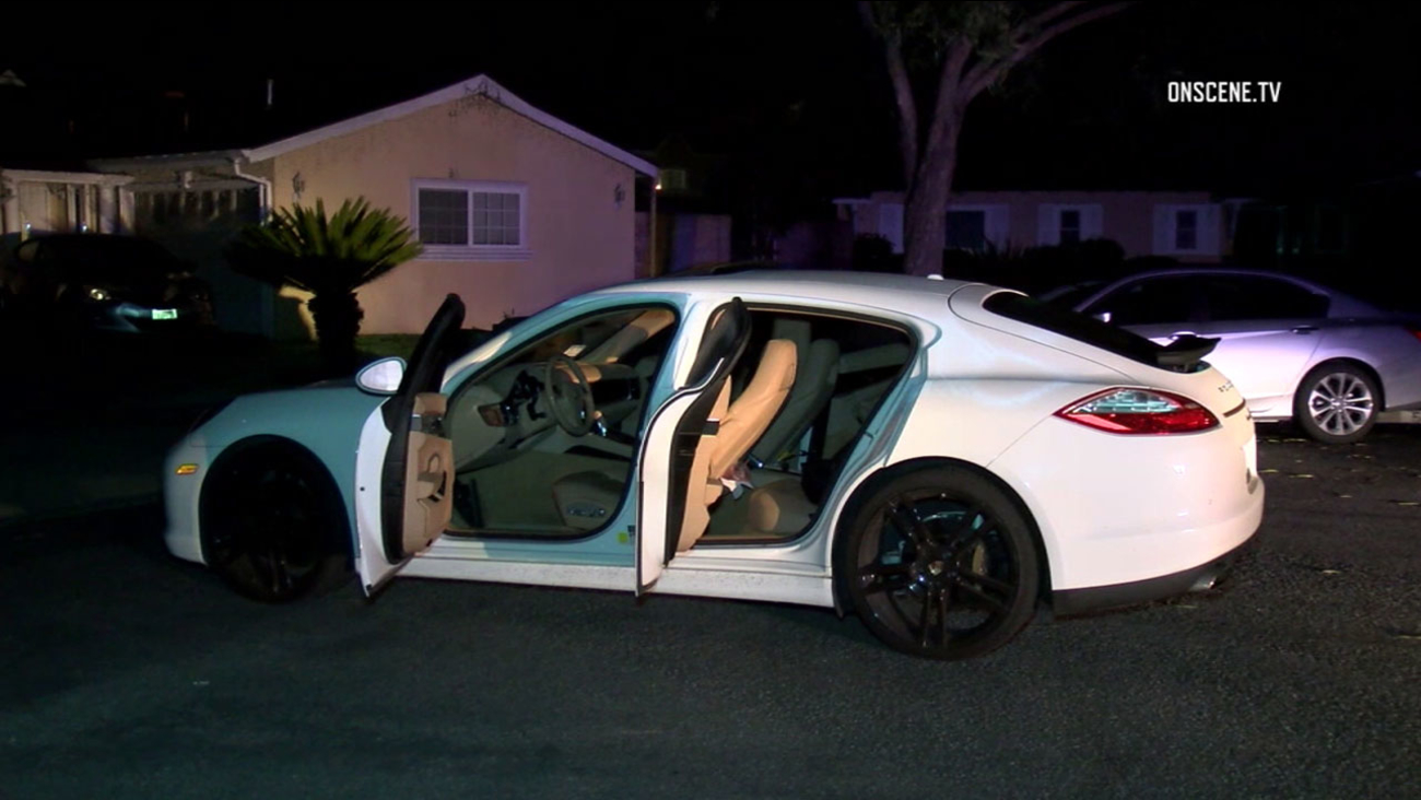 Authorities investigated the aftermath of a police chase after home-invasion robbery suspects fled from a stolen Porsche in La Palma on Thursday, Feb. 16, 2017.