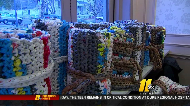 Group crocheting mats for refugees