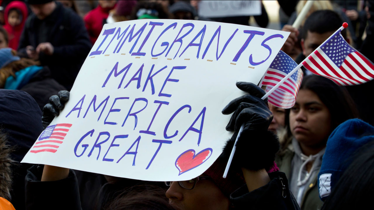Supporters of immigrants' rights march in downtown Washington during an immigration protest Thursday, Feb. 16, 2017, in Washington.