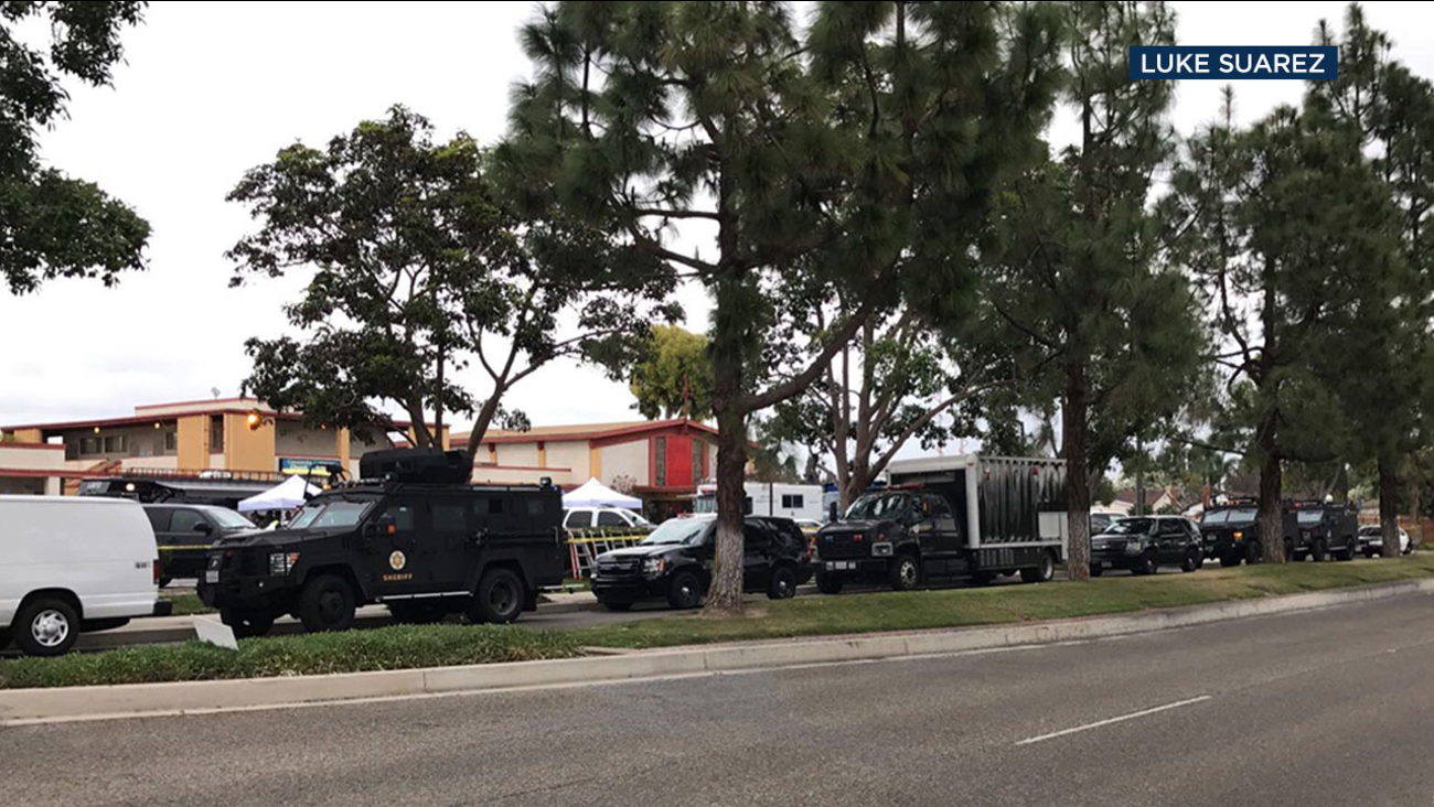 A suspect died during a confrontation and gunfight with Long Beach SWAT officers in Cerritos.